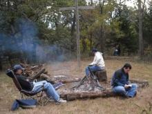 men campfire